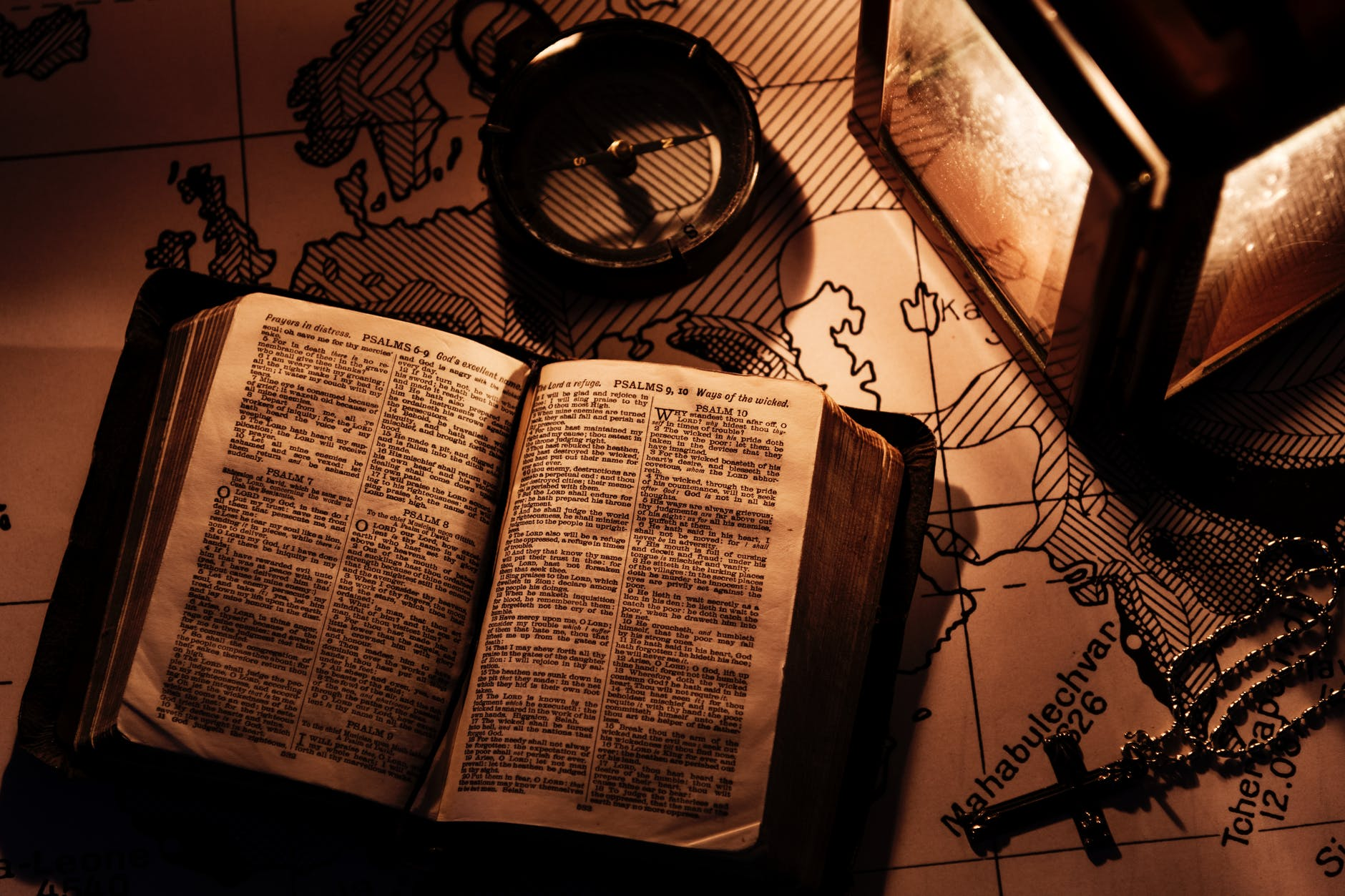opened bible on wooden surfaca